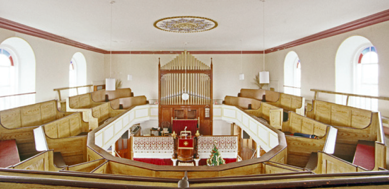 Interior of St. Just Wesleyan Reform Chapel showing grained pews.(Source: English Heritage. Phot credit Eric Berry)