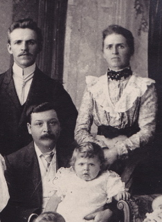 My father on his father's knee in 1900. His mother at rear.